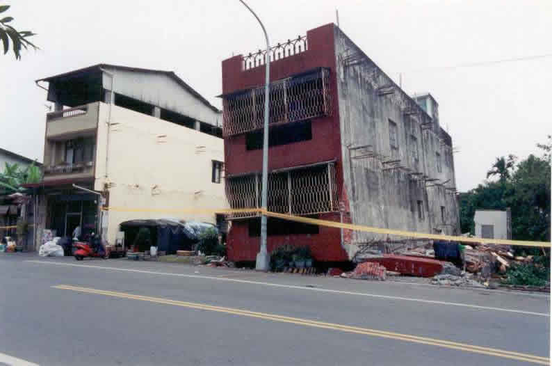 Earthquake damage - Collapsed Three-story building in the 1999 Chi Chi earthquake (Source: EERI 2001)