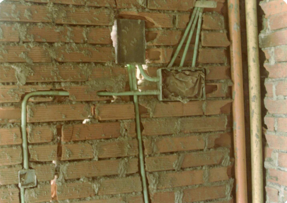 Key Seismic Deficiencies: Wall Weakness due to Electrical and Water Conduits