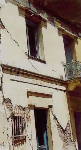 Typical Earthquake Damage - Falling of Plaster and Shear Cracking of the Walls (1999 Athens Earthquake)
