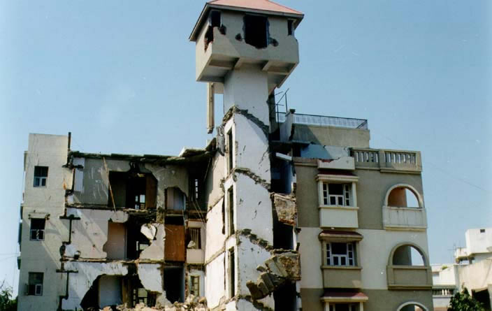Underutilization of Shear Capacity of Elevator Core Due to Improper Diaphragm Action of Slabs Resulted in Failure of an Apartment Building (2001 Bhuj Earthquake)