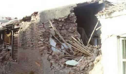 Typical Earthquake Damage - Wall Collapse Due to Poor Quality Brick Construction and Poor Inadequate Wall Connections in the 2001 Bhuj Earthquake (Source: IIT Powai 2001)