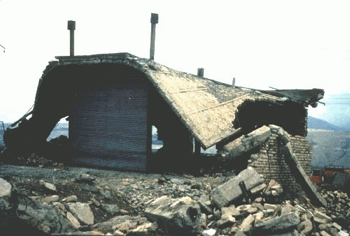 The 1990 Rudbar Manjil Earthquake, Partial Collapse of the Storey, Buckling of the Bracing, and permanent Sidesway (EERI Slide Collection)
