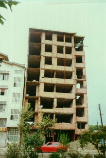 Minor damage due to pounding between two adjacent buildings in the 1990 Manjil earthquake