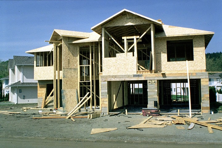 A contemporary two-story wood house under construction