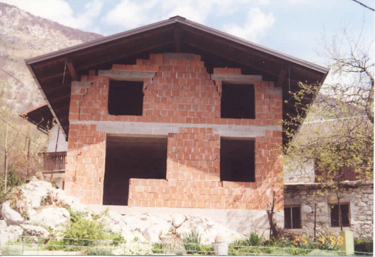 Typical Earthquake Damage: A House without Vertical Tie-Columns and without Top Bond-Beams in Attics (1988 Bovec earthquake)
