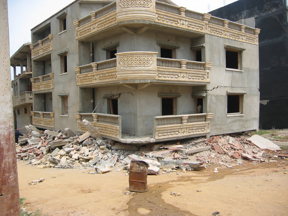 Typical Earthquake Damage: Buildingcollapse Due To The Soft Storey Effect  (2003Boumerdes Earthquake)