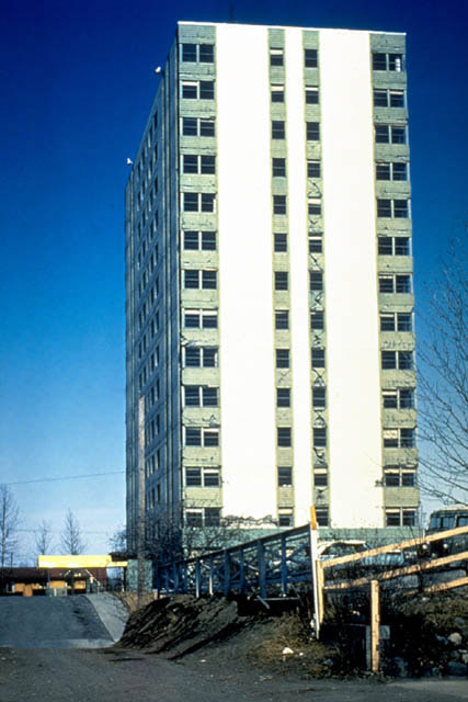 Overall view of the 1200 L Street Apartment building, Anchorage, Alaska after damage from the 1964 earthquake. This 14-story reinforced concrete structure has a basic lateral-resisting structural system and a series of slender walls