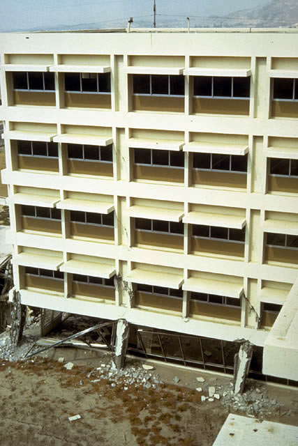Olive View Hospital, Medical Treatment and Care Unit, 1971 San Fernando earthquake. View of the end of one of the four wings of this 5-story reinforced concrete building after the earthquake.