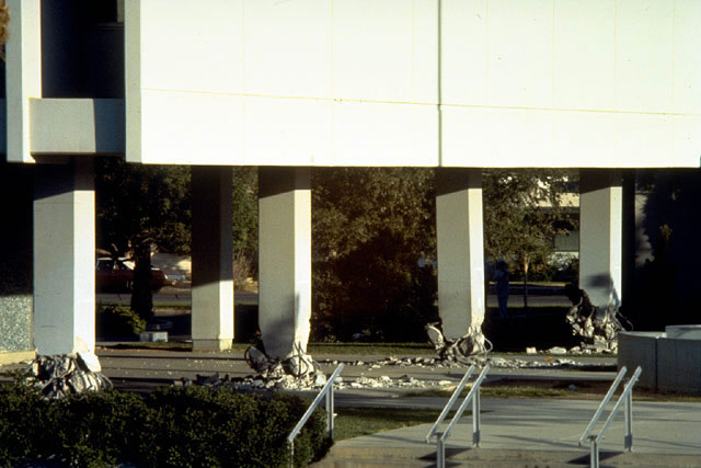 View of the 1979 Imperial Valley earthquake damage in the first story columns located in the east end of the Imperial County Services building. Note the explosive type of failure just above the ground.