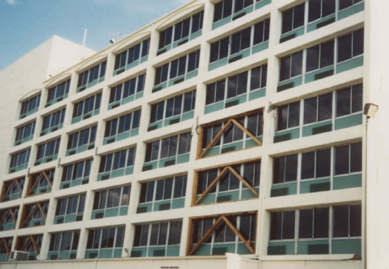 View of Holiday Inn, Van Nuys, CA with damage from the 1994 Northridge earthquake. The lateral system consists of reinforced concrete perimeter moment frames.