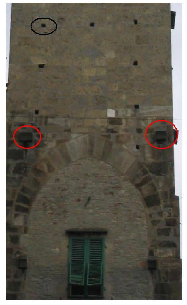 """Il Campano"" (bell tower): detail of the holes (black circle) made to support the framework (while the tower was being built) and the balcony after it was finished. The balconies were also strengthened by wood beams supported by shaped stones"