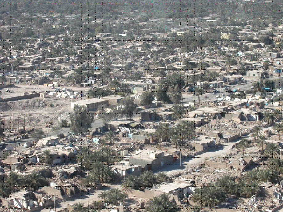 Aerial view of neighborhood with widespread damage to adobe structures in Bam earthquake