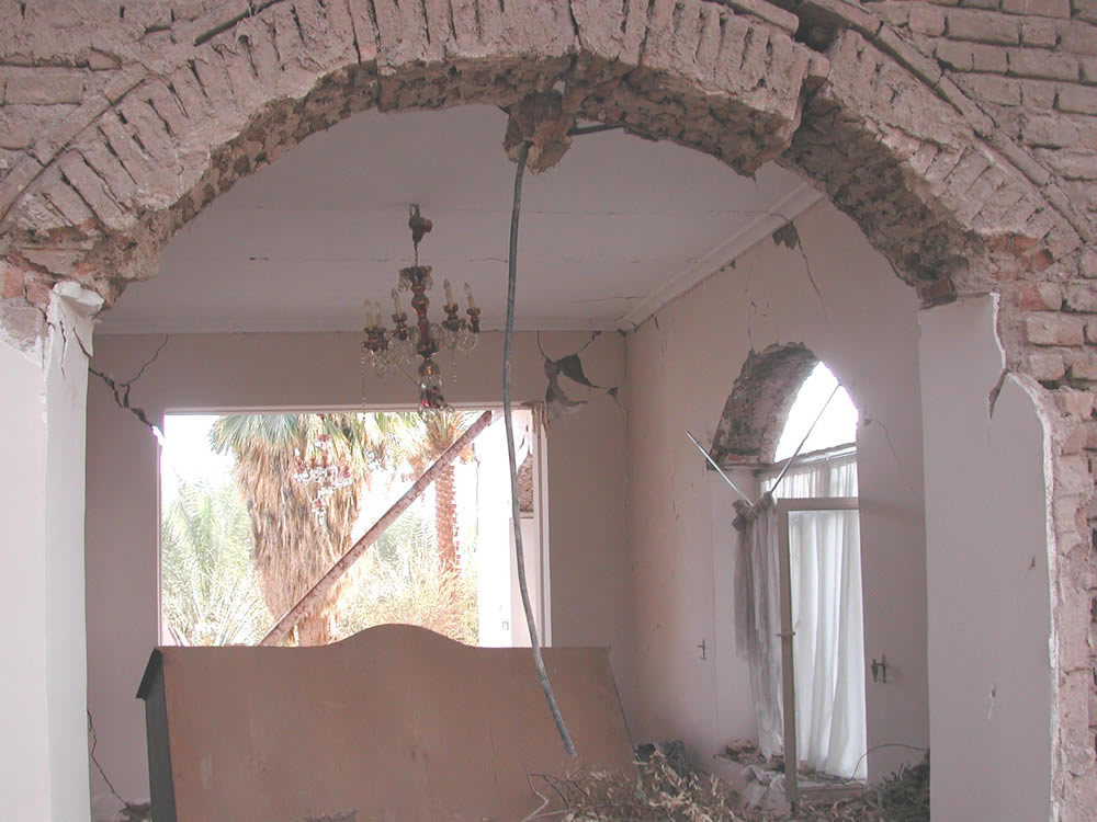 Bam earthquake: Damage to a traditional adobe house. Non-bearing walls collapsed, bearing walls are still standing