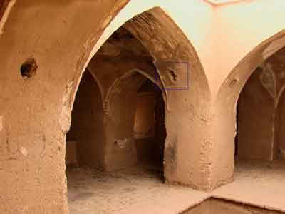 The holes that carry the timber tiebeams to prevent slipping the roof. This building islocated in the city of Aqda, province of Yazd.