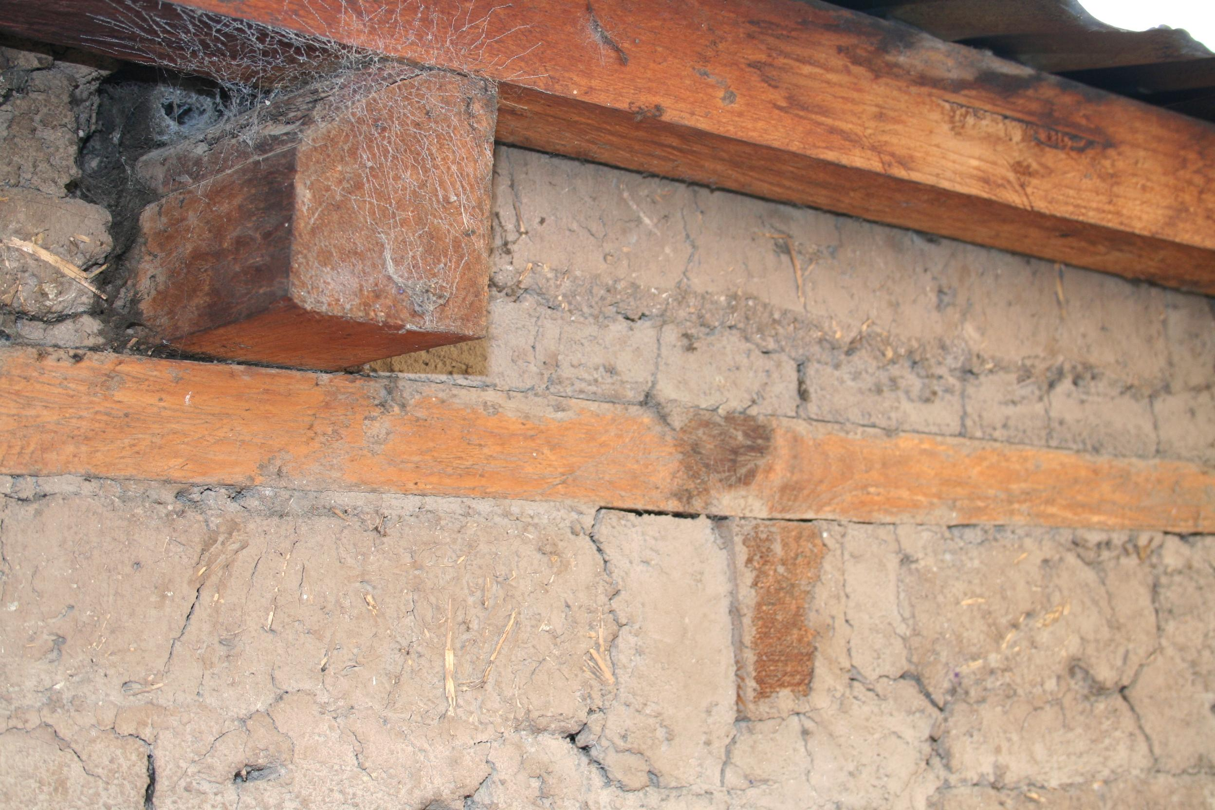 Connection of roof framing to wall incorporating a timber ring beam.