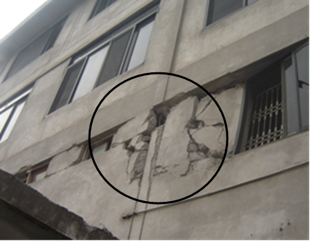 Building being supported by infill walls after failure