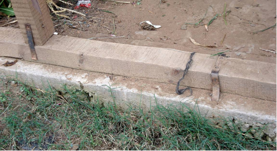 Timber ground beam (or sill beam) raised above the ground to protect the timber frame from rotting. Note attempted connection of the timber beam with the foundation. Damp proof course not provided.