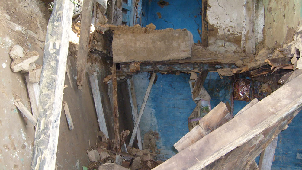 Collapsed timber floor structure of an abandoned house in Simla, India. (Note: Layer of mud laid on floor structure).
