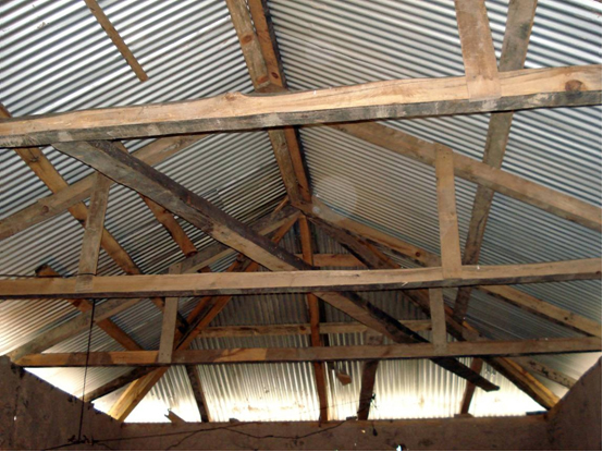 An internal view of a hipped roof. Apart from the CGI sheets there is no bracing to stiffen the roof structure. (Note: This roof is likely for storage/use. There will be a floor and ceiling of some kind added at a later date depending on the budget availa