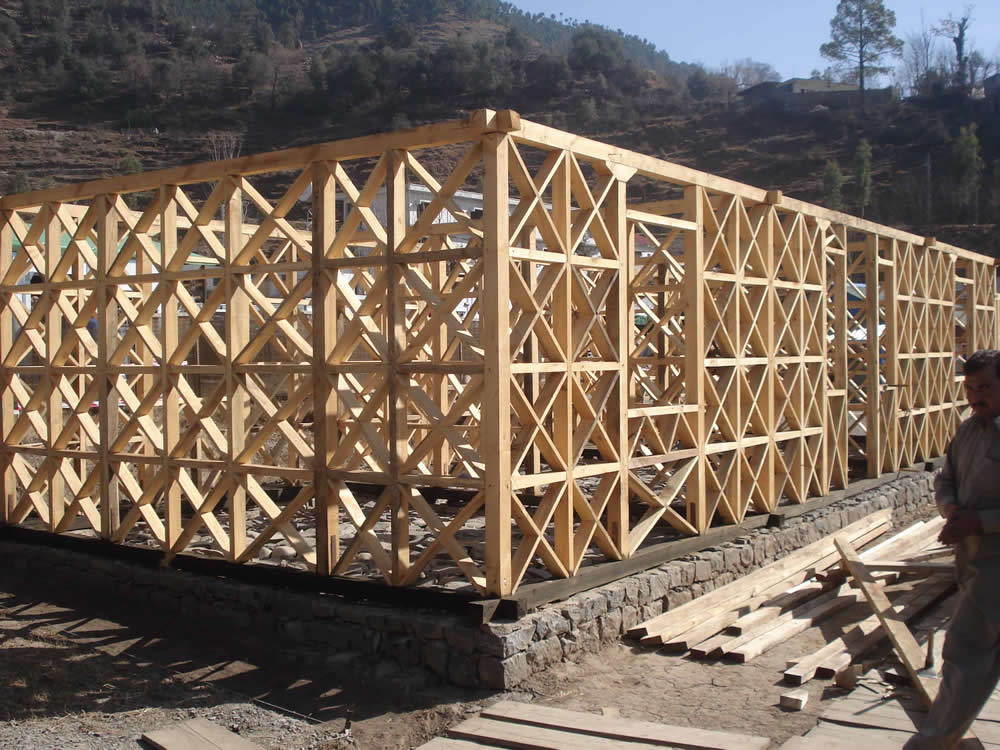 Engineered dhajji building frame under construction.
