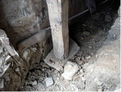 Example of effort to provide foundation to a timber post to reduce the immediate settlements under the post and provide limited protection to the timber end grain from moisture.