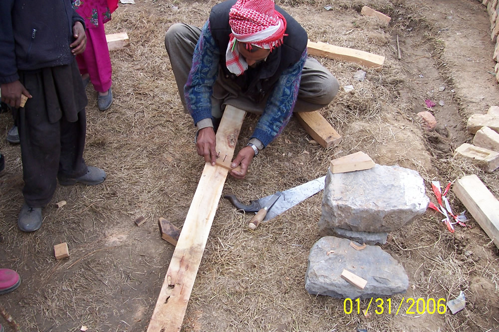 Improvised tools to guide the carpenter made from scrap wood and nails on an ad hoc basis.