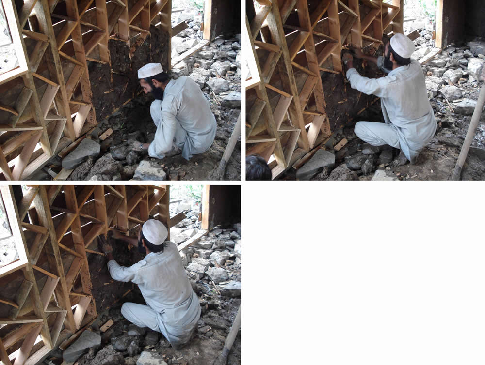 Construction of the infill walls continued. Note: Note he was breaking the stones as he went along. Previously large stones from an old unreinforced stone house on the same site.