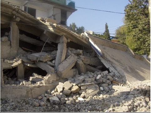 Total structural collapse of reinforced-concrete building in 2005 Kashmir earthquake.