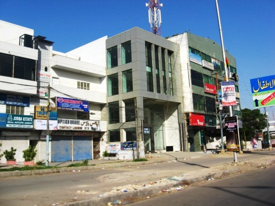 G+3 RC commercial building in Karachi #metal cladding on exterior faces.