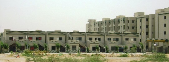 RC houses in Karachi - G+1 bungalows with similar  rectangular plans, and multistory apartments.