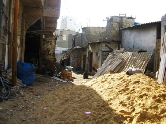 Low income RC construction, with materials stacked  on site - Karachi.